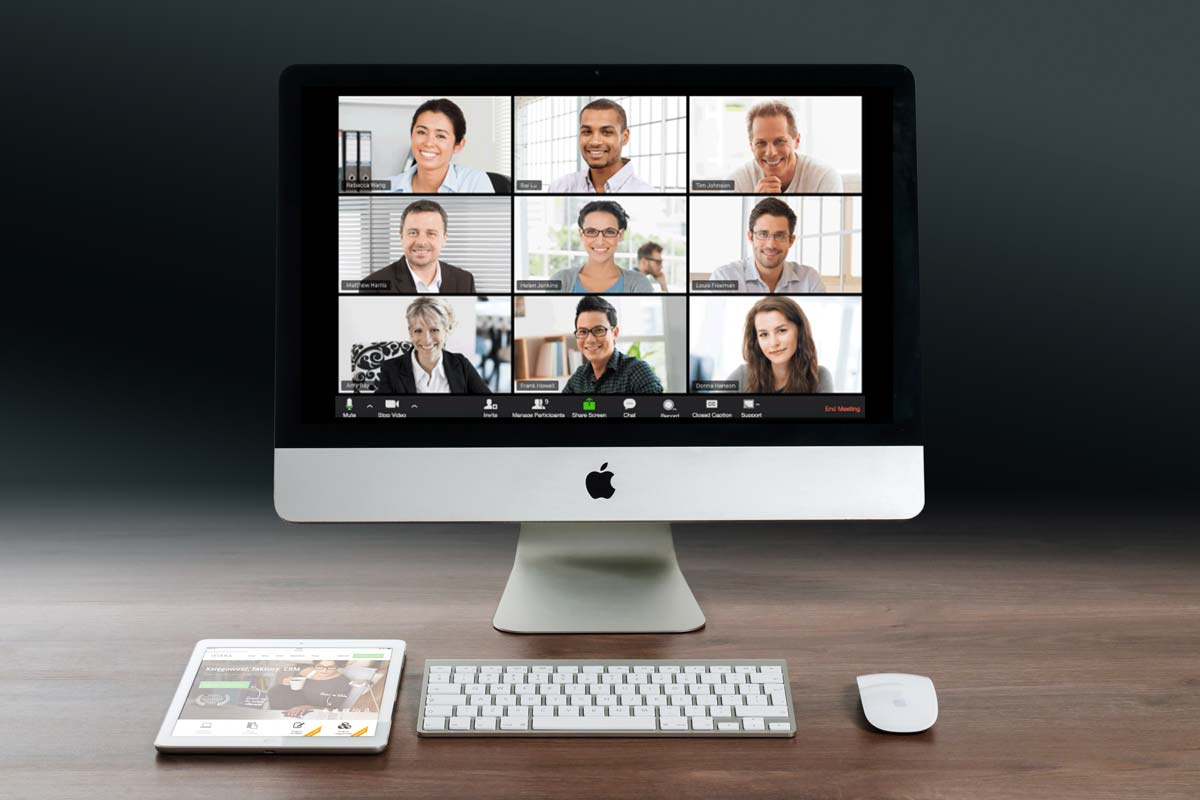 9 people displayed on a video chat computer screen..