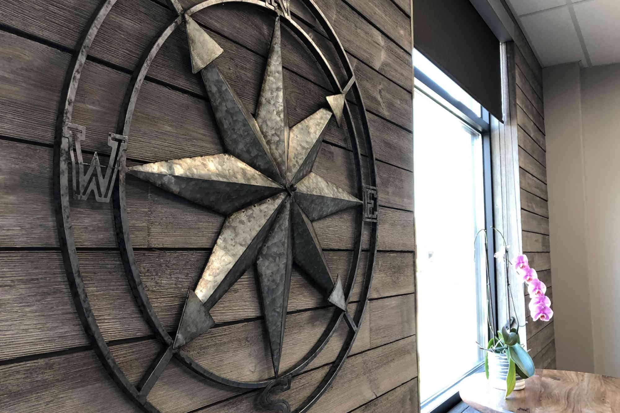 The big metal compass inside of Deliberate Direction's conference room
